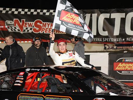 Sammy Smith in victory lane Sunday at New Smyrna Speedway