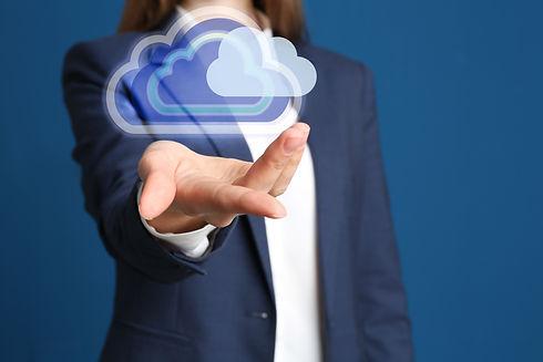 Woman holding virtual clouds icon on blu
