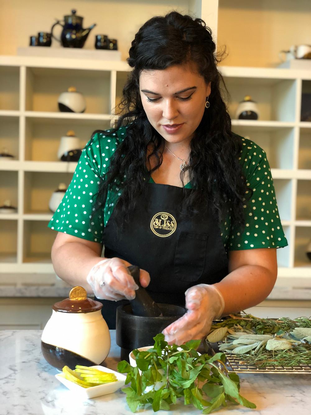 Women blending herbs