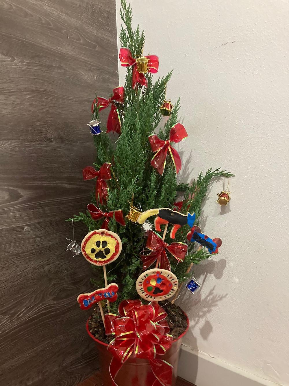 Decorating the Christmas tree with the DIY pet keepsake: Christmas ornaments