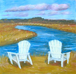 2 chairs by the water