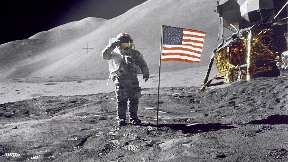 Fake Moon Landing Astronaut Salutes the American Flag (Credit: OZY)