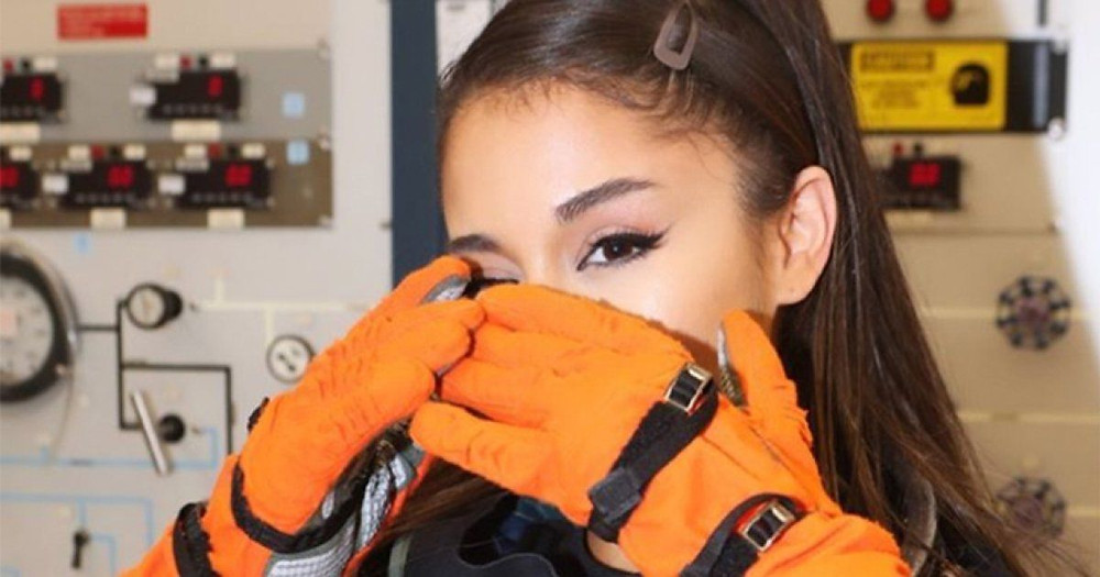 Ariana Grande dresses up as an astronaut during NASA space center visit (Credit: Yahoo News)