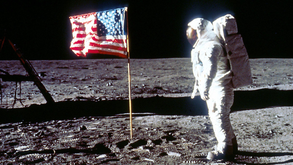 Buzz Aldrin Astronaut Standing Next to the American Flag on the Moon (Credit: Sky.com)