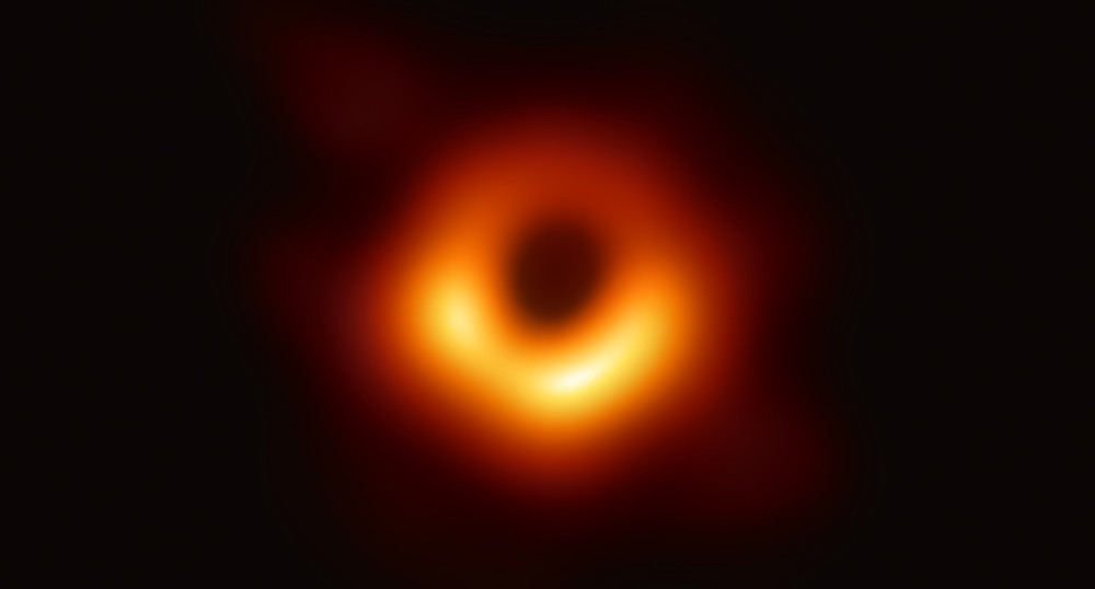 The First-Ever Image Photograph of a Real Black Hole in M87 (Credit: Time Magazine)