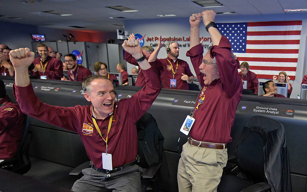 Kris Bruvold, left, and Sandy Krasner react after receiving confirmation that the Mars InSight lander successfully touched down on the surface of Mars (Source: Space.com)