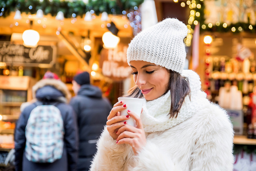 Sipping a hot drink at the beautiful Christmas markets in Europe.