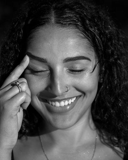 monochrome-photo-of-smiling-woman-touchi