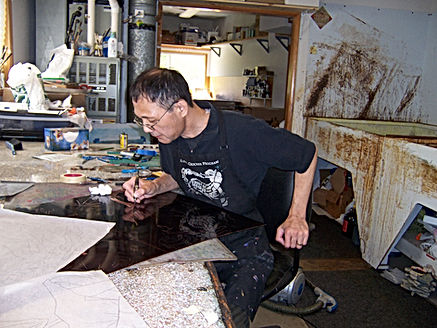photograph by contemporary Japanese print dealer Allison Tolman of The Tolman Collection of New York of artist HIRATSUKA Yuji in his studio