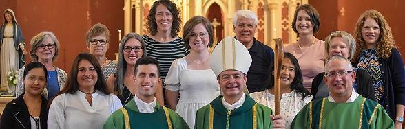 Fr G with Parish Staff-2-cropped(1)_.jpg