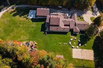 aerial view of the main lodge at the camp