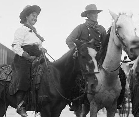 1908 Cowgirl and cowboy on horseback