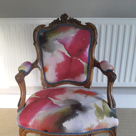 After: completely reupholstered from frame up using traditional materials and techniques.  Fabric: Harlequin, Flores.