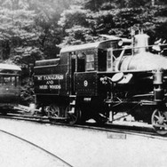 """circa 1922 - Two pieces of Tamalpais rolling stock (left to right) """"Motor No. 3"""", a gasoline powered Kissel Kar and engine No. 9, just outside the railroad's workshop in Blithedale Canyon."""