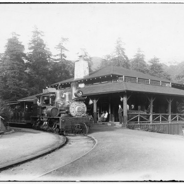 circa 1912 - Tamalpais engine No. 3, a Shay, at the first Muir Inn. Inside was the lobby, a restaurant and a bar. John Muir, himself, dined here. Overnight guests stayed in nearby cabins. This Inn opened June 27,1908 and burned to the ground June 12, 1913.