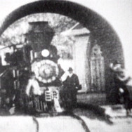 Thomas Edison's Kinetoscope film crew shot three short movie clips on the mountain railway in March 1898. The very first movies were seen by the public three years earlier. This still frame shows the first Tamalpais Heisler locomotive, No. 2, at the archway of the Tavern of Tamalpais. This was a huge PR boost for the railroad because Edison's biggest audience was on the East Coast.