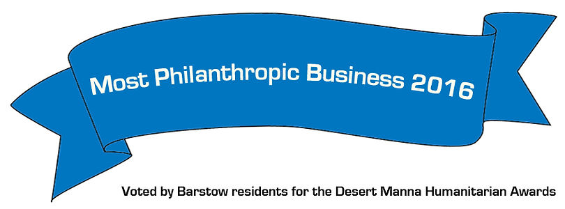 "a blue banner announces Stewart's United Agencies as ""Most Philanthropic Business 2016,"" as voted by Barstow Residents for the Desert Manna Humanitarian Award"