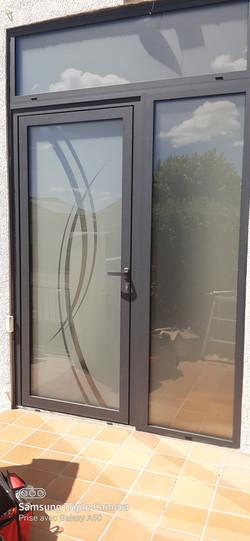 c13  fermeture d'un porche d'entrée