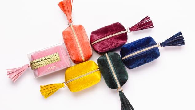 jewel-tone mini velvet cases that contain emergency items