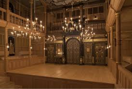 The Wanamaker Theatre stage lit by candles.