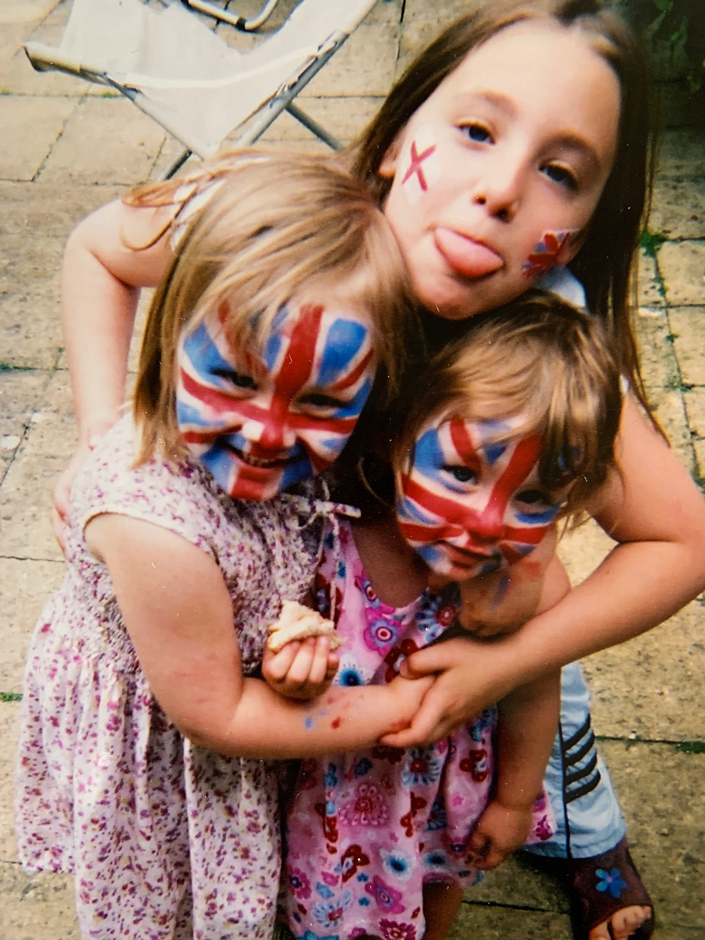 three girls with flags painted on their faces