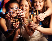 Group of partying girls clinking flutes