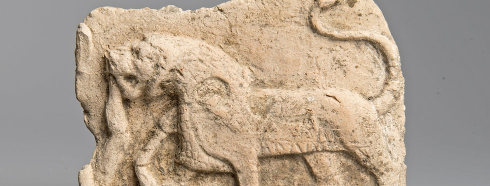 Babylonian terracotta plaque of a lion eating a human