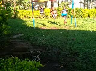 Enjoying the sun after rain in Lockdown the boys in the background tending the vegetable garden