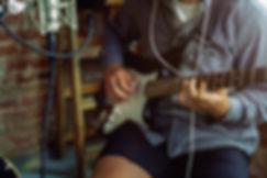 young-man-recording-music-playing-guitar
