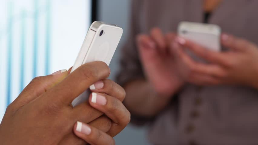 Hands holding cell phone.jpg