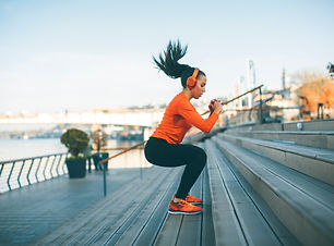 Fitness woman jumping outdoor in urban e