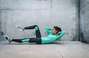 Young woman performing core crunch exerc