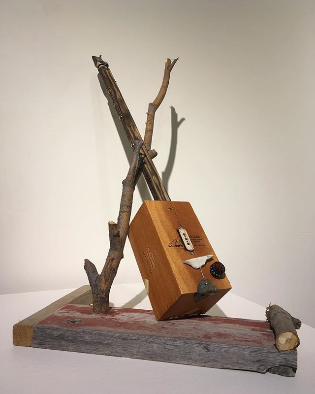 Guitars as art... one of my didley bows on display at the Jamestown Art Center..._._._