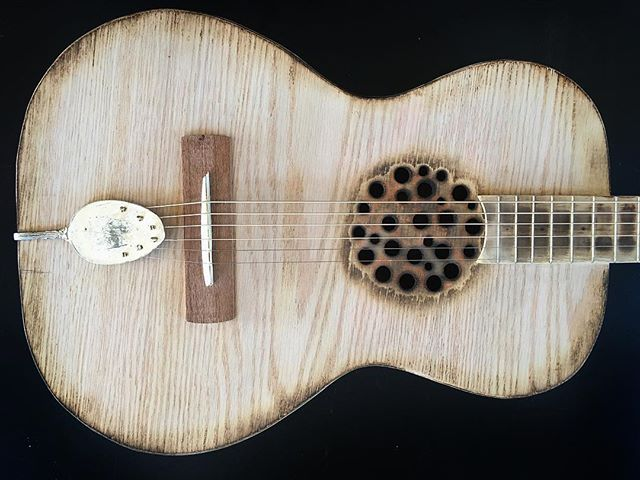 Number 192 acoustic lap steel... the action is set extra high on this acoustic and perfect for playi
