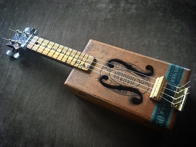 My wife's cigar box tenor ukulele... one of my favorite builds