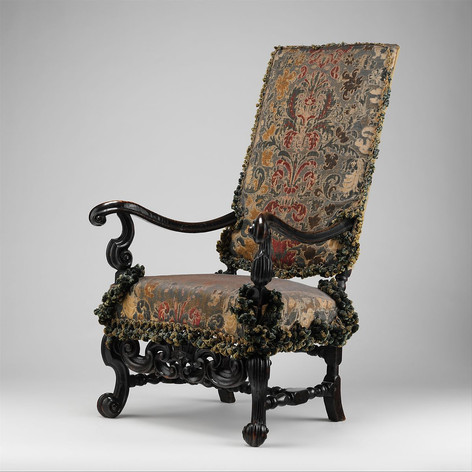Upholstered armchair, originally from a set of eight, from Burley-on-the-Hill, Rutland (one of a pair) ca. 1689. Attributed to Thomas Roberts