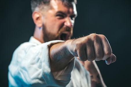 Sportsman martial art taekwondo training, in karate position. MMA - Mixed martial art. Sel