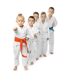 Little children practicing karate on whi