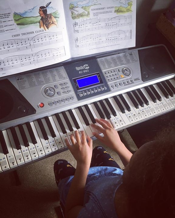 My 6 year old practising her music lessons for piano - Fijian In the UK