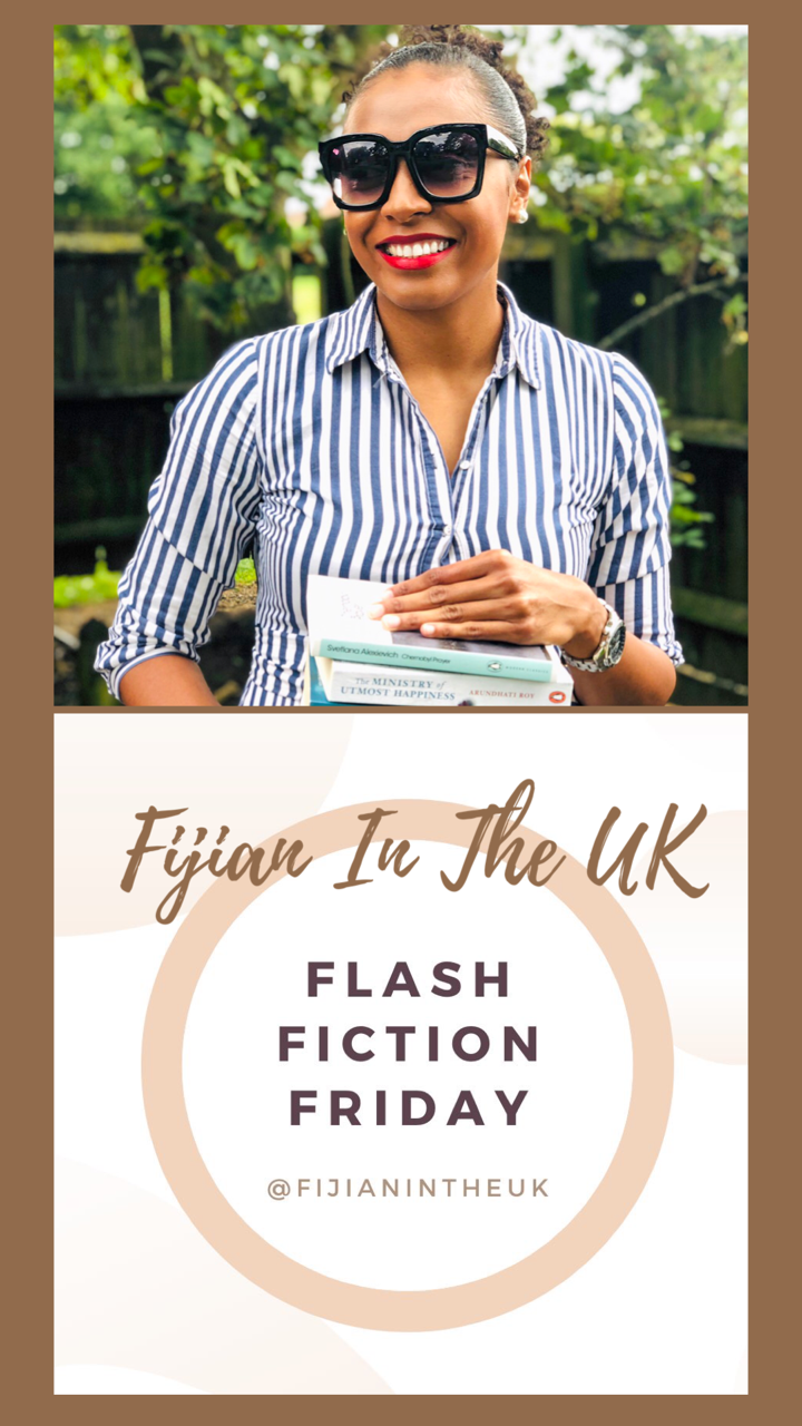 Isabella is wearing a blue and white striped long sleeve dress. She is also wearing a pair of dark glasses and is smiling into the camera. She carries books in her hands. Below this picture is a logo for Fijian In The UK which is in earthy brown and beige tones