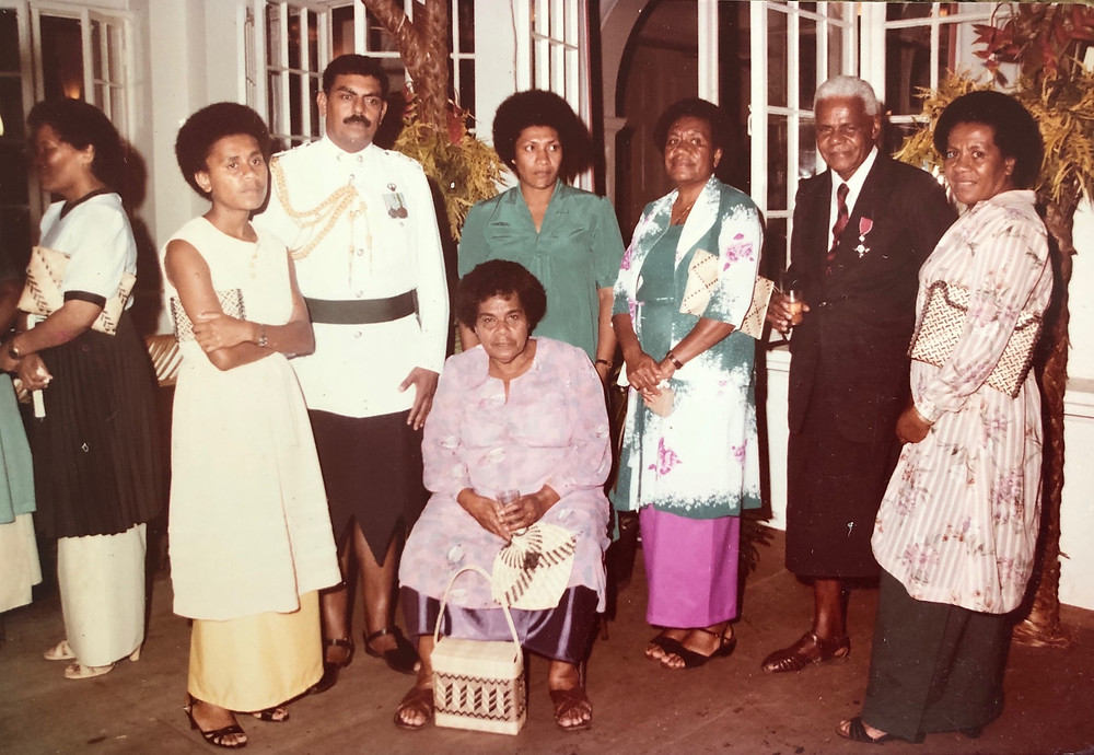 Fijian In the UK - My mother and my grandparents with other members of our extended family at the celebration ceremony for my grandfather receiving his MBE medal