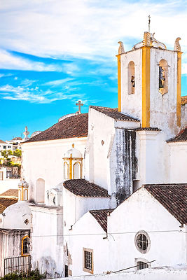 Church and white facades in Tavira, Portugal