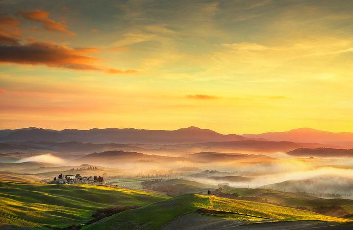 Volterra foggy panorama at sunset