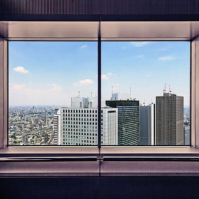 Shinjuku Skyscrapers through a window. Tokyo
