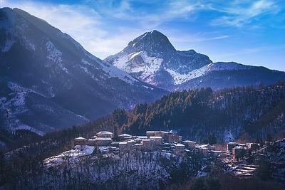 Snowy village in Alpi Apuane