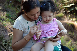 Mother reading book with her two year's