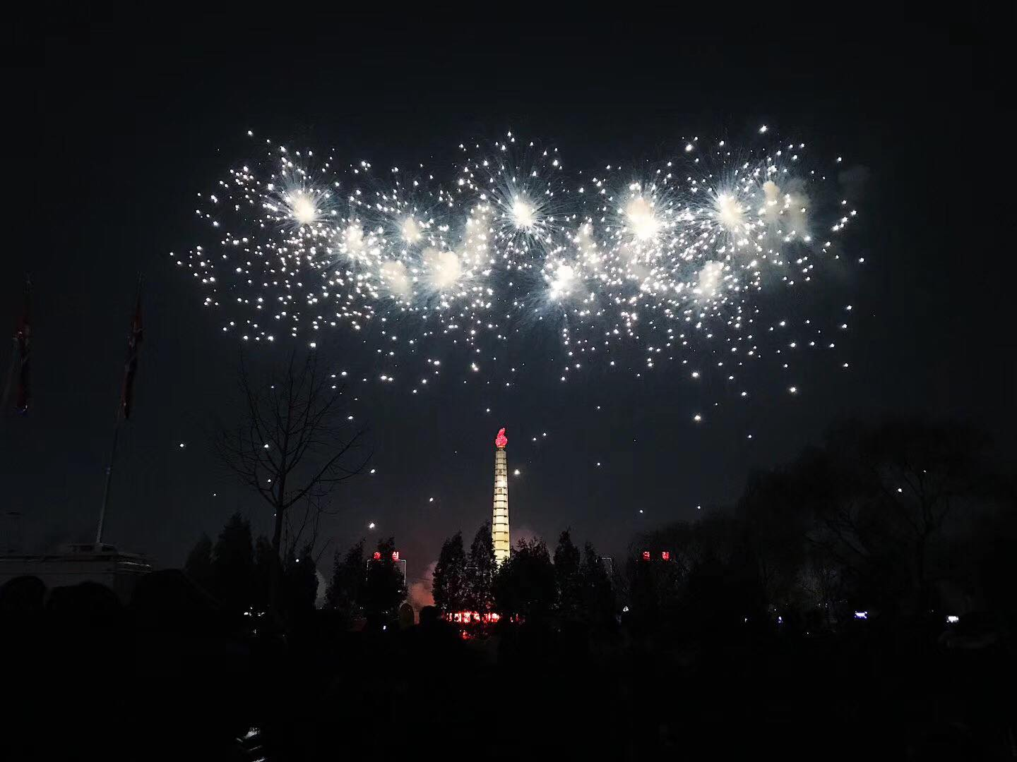 Fireworks for new year of 2018. Right across the Daedong River is the Juche Tower.