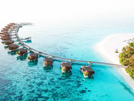 Where in the world can you vacation in a bungalow built over the water?