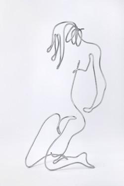girl kneeling by arik afek