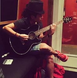 Junya Playing Guitar